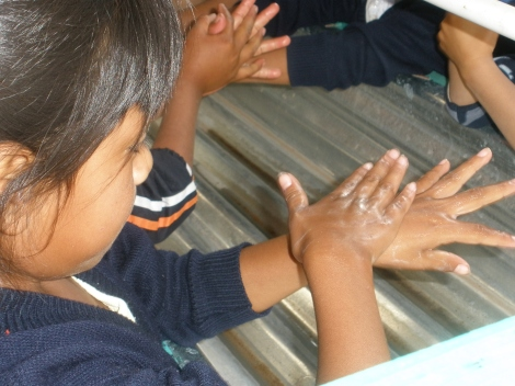 Washing hands. Practice makes perfect in a Guatemalan clinic.