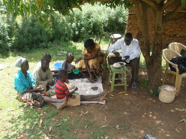 Rasoa Wasike serves lunch to her family.
